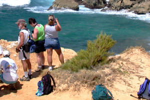 Group tours the Mahaulepu beach and cliffs